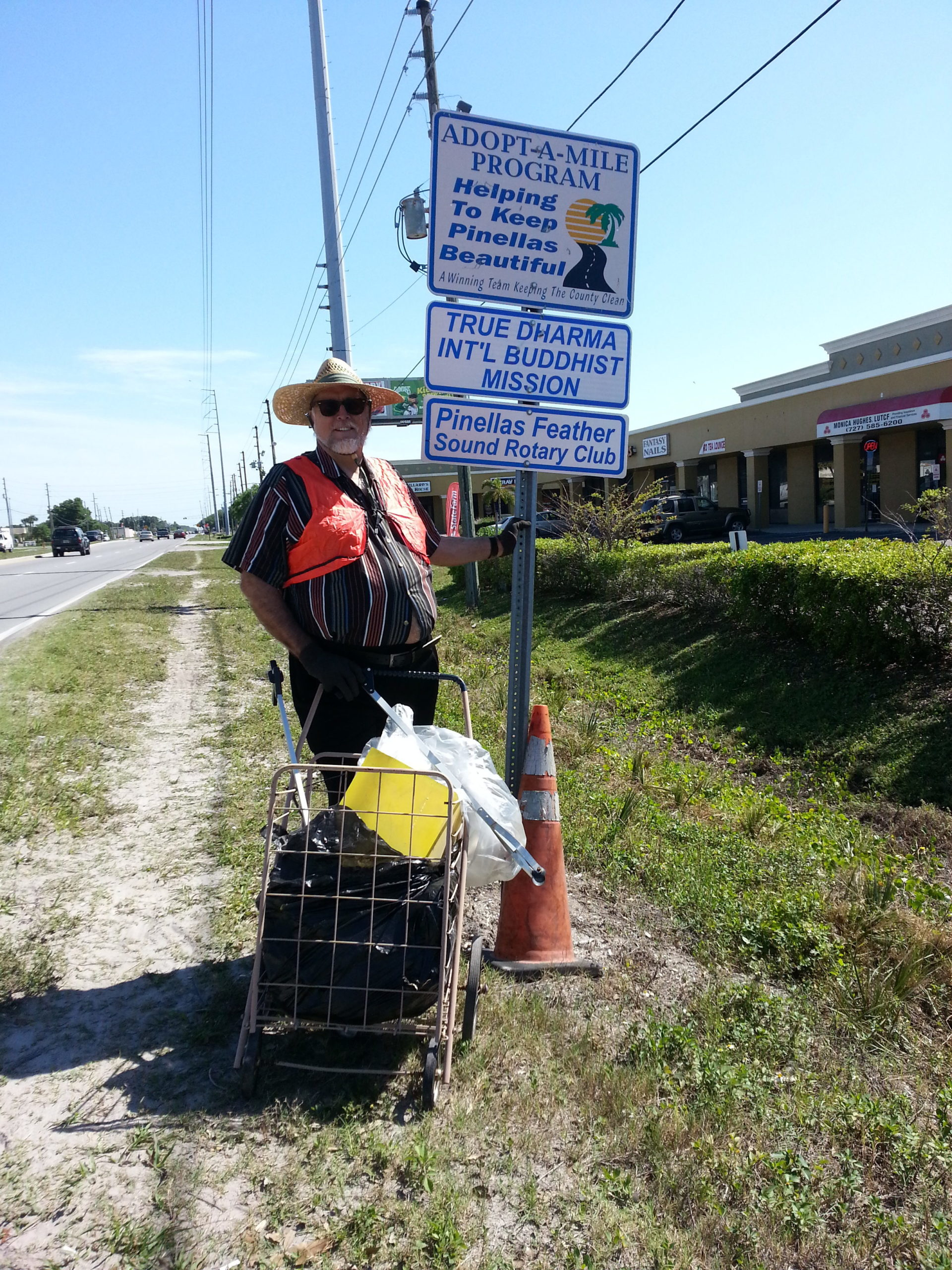 Community Activist Jay Alexander does volunteer road clean-up with True Dharma